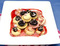 Macarons. Cookies decorated with jam, chocolate and cream stock images