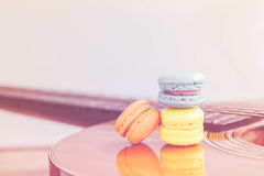 Macarons on Acoustic guitars,vintage style Stock Photos