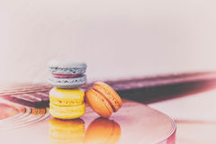 Macarons on Acoustic guitars, vintage style. Royalty Free Stock Photos