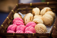Macarons assortment in a wickered box Stock Photos