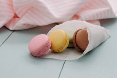 Macarons in backing paper cornet Stock Photo