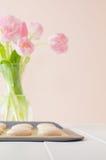 Macarons on baking sheet with tulips Stock Photo