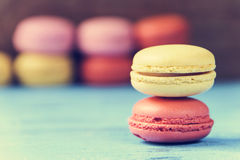 Macarons on a blue rustic surface, cross processed Royalty Free Stock Image