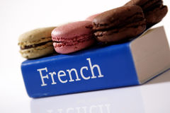 Macarons on a book. Macarons on a French dictionary Royalty Free Stock Images