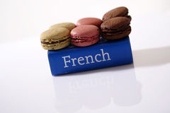Macarons on a book. Macarons on a French dictionary Stock Images