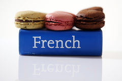 Macarons on a book. Macarons on a French dictionary Stock Photography