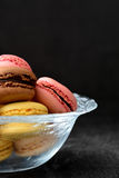 Macarons in a bowl. Black background Royalty Free Stock Image