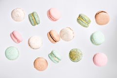 Macarons cake, top view flat lay, fly falling macaroon background. Colorful macarons cake, top view flat lay, fly falling sweet macaroon on color white isolated Stock Photography