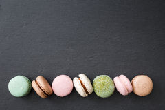 Macarons cake, top view flat lay, macaroon on black background Stock Photo