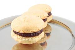 Macarons with chocolate Stock Photos