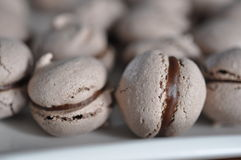 Macarons. Chocolate fill brown chocolate on plate delicious Stock Photo