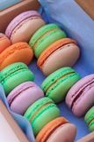 Macarons close-up in a box. Delicious sweet buffet with colorful macarons in a box Stock Images