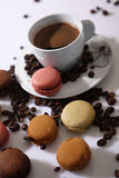 Macarons and coffee beans. Cup of coffee and macarons for breakfast Royalty Free Stock Photography