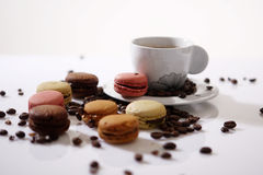 Macarons and coffee beans stock photo
