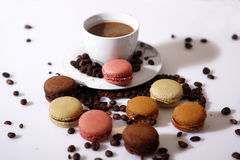 Macarons and coffee beans Royalty Free Stock Images