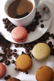 Macarons and coffee beans. A cup of coffee and some macarons for breakfast Stock Photography