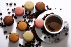 Macarons and coffee beans Stock Photos