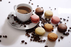 Macarons and coffee beans Stock Image