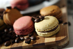 Macarons and coffee beans Royalty Free Stock Photography