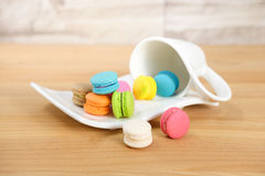 Macarons. Colorful macarons out of a cup on wooden background, selective focus, Dessert Royalty Free Stock Photography