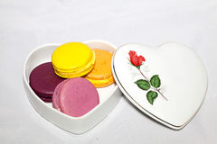Macarons is colorful and sweeties dessert. Macarons is colorful and sweeties dessert on white background stock images