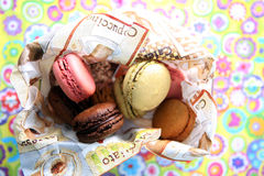 Macarons. Coloured macarons in a napkin, floral background Stock Photo