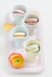 Macarons. Colourful macarons in in eggcups Royalty Free Stock Photo