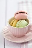 Macarons. Colourful macarons in a rosy cup Stock Photography
