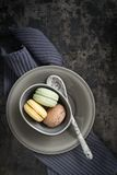 Macarons. Colourful macarons in a small cup stock photo