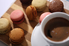 Macarons and a cup of coffee Stock Images