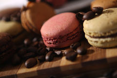 Macarons and a cup of coffee Stock Photos