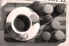 Macarons and a cup of coffee. Coffee and some macarons for breakfast Royalty Free Stock Images