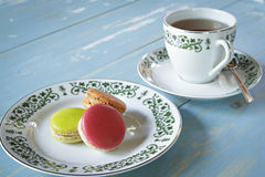Macarons with a cup of tea Royalty Free Stock Images