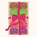 Macarons dans une boîte illustration de vecteur