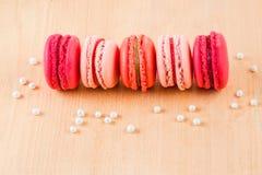 Macarons de fraise, de framboise et de rhubarbe Photographie stock libre de droits