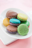Macarons in dish. On pink table Royalty Free Stock Images