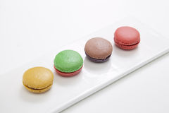 Macarons in dish. On pink table Stock Images