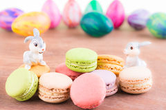 Macarons with Easter egg and bunnies Royalty Free Stock Photos