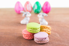 Macarons with Easter egg and bunnies Stock Photo