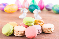 Macarons with Easter egg and bunnies Royalty Free Stock Images