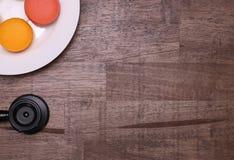 macarons et stéthoscope Image libre de droits
