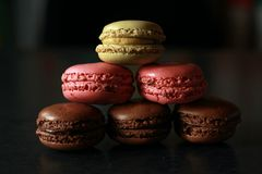 Macarons. French macarons on a black background Stock Photos