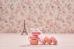 Macarons french dessert. Eiffel Tower on wood Royalty Free Stock Photos