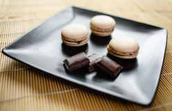Macarons. Fresh chocolate macarons on  the table Royalty Free Stock Photo