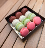 Macarons on a gift box Royalty Free Stock Photos