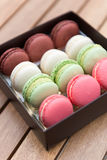 Macarons on a gift box Royalty Free Stock Images