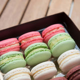 Macarons on a gift box Stock Photo