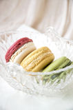 Macarons in glass basket Stock Images