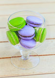 Macarons in glass bowl. Delicious sweet buffet with colorful glass bowl of macarons Stock Photography