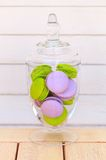 Macarons glass bowl on white background. Delicious sweet buffet with colorful glass bowl of macarons Stock Image
